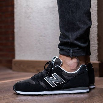 373 new balance black and gold